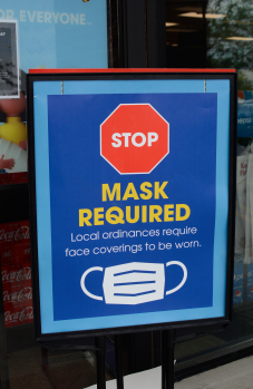 A sign at the Winchester Kroger reminds customers that masks are required to enter the store. Kentucky Gov. Andy Beshear has issued an order mandating face coverings, but starting Wednesday, Kroger stores nationwide are also requiring it.
